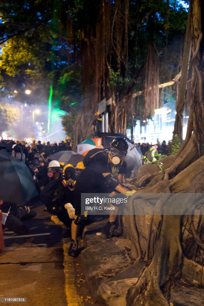 Protesters Take Cover From Tear Gas And Rubber Bullets Fired