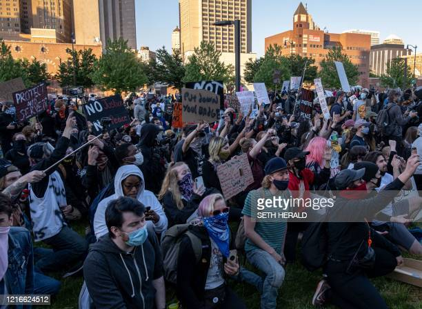 Protesters take knee and chant in front of the Detroit police station as they demonstrate in Detroit, Michigan on May 31, 2020 following a night of...