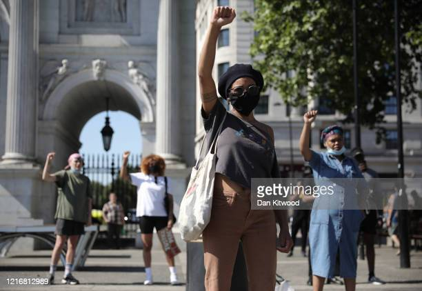 Protesters take part in a 'Black Lives Matter' demonstration near Marble Arch on June 01 2020 in London England Protests and riots continue across...