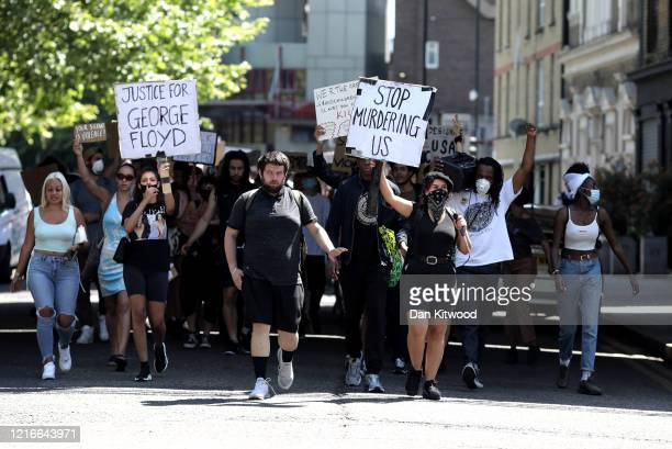 Protesters take part in a 'Black Lives Matter' demonstration through Brixton on June 01 2020 in London England Protests and riots continue across...