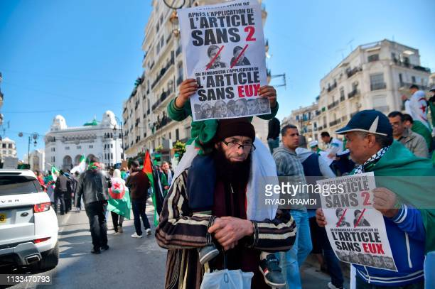 TOPSHOT Protesters take part in a demonstration against ailing President Abdelaziz Bouteflika in the capital Algiers on March 29 2019 Opposition to...