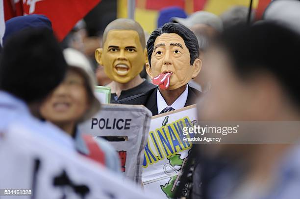 Protesters take part in a demonstration against the G7 Summit on May 26, 2016 in Tsu City, Mie Prefecture, Japan, while G7 Summit 2016 is held in...