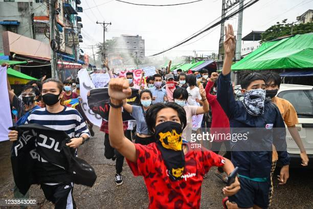 Protesters take part in a demonstration against the military coup and to mark the anniversary of 1962 student protests against the country's first...
