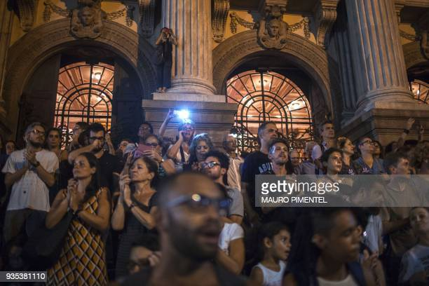 Protesters take part in a demonstration against the murder of Brazilian councilwoman and activist Marielle Franco in front of Rio's Municipal Chamber...
