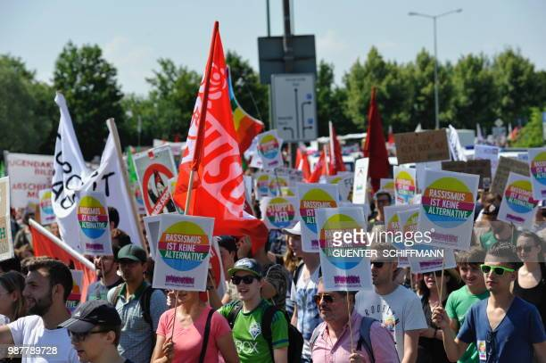 Protesters take part in a demonstration against the twoday party congress of Germany's farright and antiimmigration party AfD in Augsburg southern...