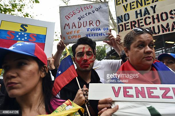 Protesters take part in a demonstration against Venezuelan President Nicolas Maduro near the United Nations headquarters in New York on September 24...