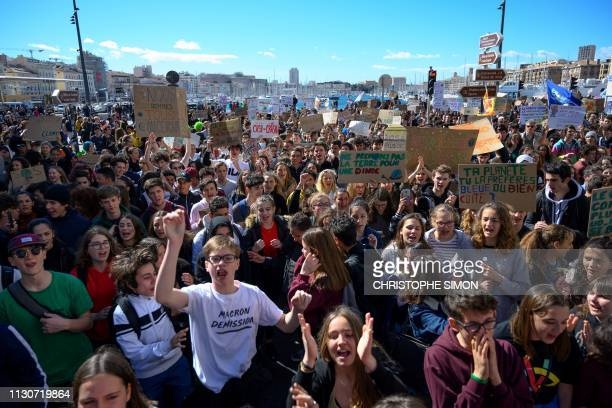 Protesters take part in a demonstration as part of a global day of student protests aiming to push world leaders into action on climate change on...