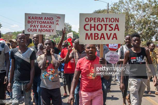 Protesters take part in a demonstration as part of nationwide antigovernment protests in Lilongwe on September 21 2018 Several hundred antigraft...