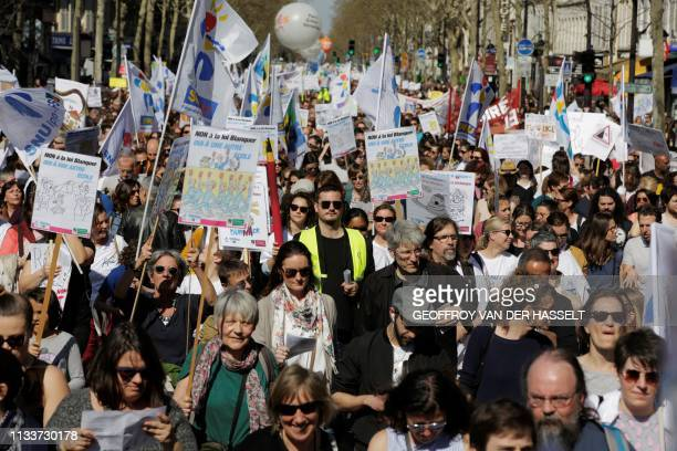 Protesters take part in a demonstration called by several French national Education unions in Paris on March 30, 2019 to protest against Education...