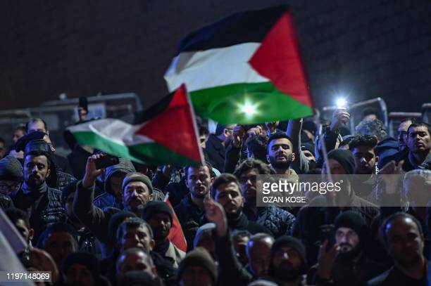 Protesters take part in a demonstration in front of the US consulate in Istanbul on January 29 to protest against the US peace plan. - Palestinians...