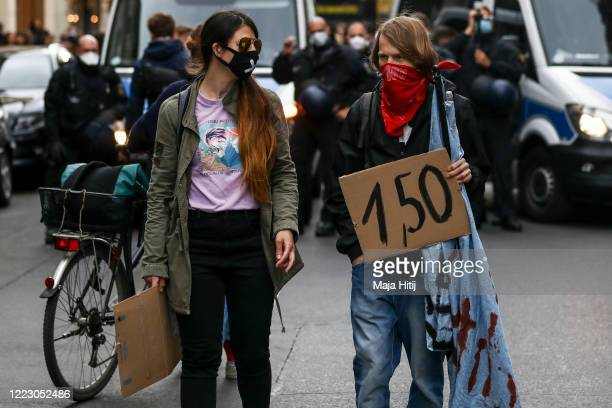 Protesters take part in a demonstration in Kreuzberg district on May Day during the novel coronavirus crisis on May 1 2020 in Berlin Germany May Day...