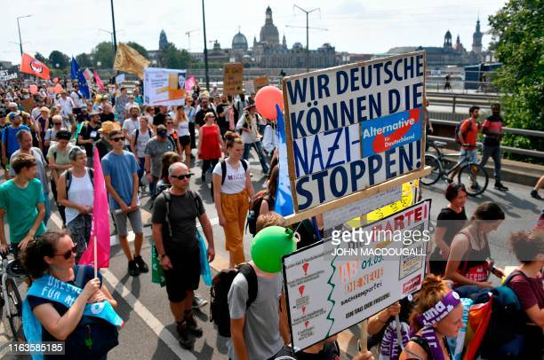 """Protesters take part in a demonstration titled """"Unteilbar"""" against exclusion on August 24, 2019 in Dresden, eastern Germany. - Thousands of civil..."""