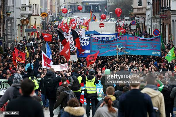 Protesters take part in a march against the G7 foreign ministers' meeting in Luebeck northern Germany on April 14 2015 The foreign ministers come...