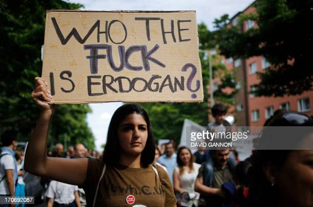 Protesters take part in a march in support of the demonstrators in Turkey in Berlin's Kreuzberg district June 16, 2013. Germany urged Turkey to...