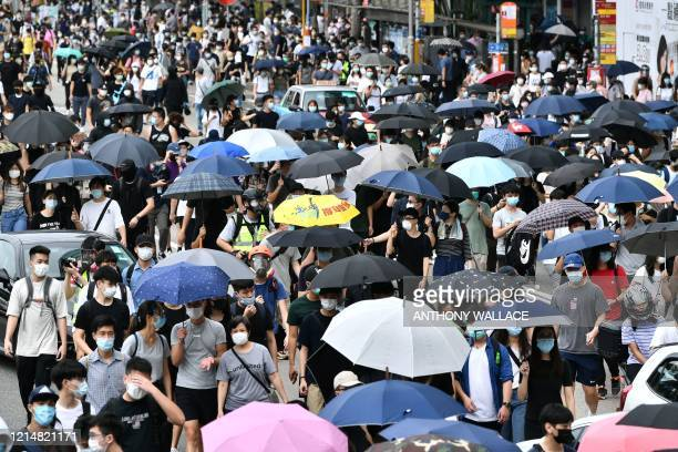 TOPSHOT Protesters take part in a prodemocracy rally against a proposed new security law in Hong Kong on May 24 2020 Police fired tear gas and water...