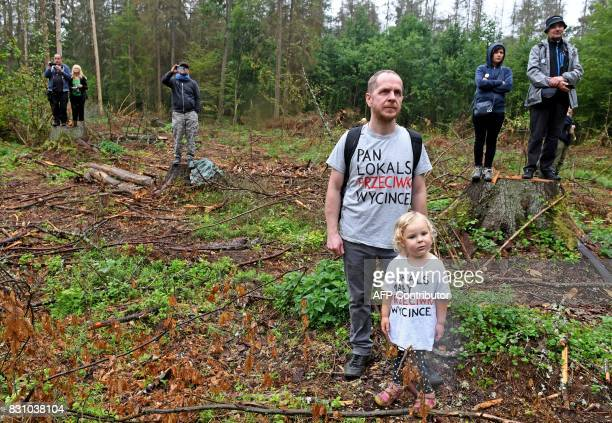 Protesters take part in a protest with tshirt reading Local citizen against logging and small local against logging against the cutting of trees in...