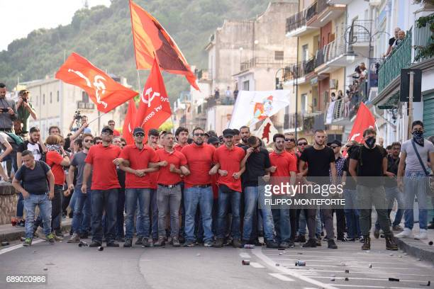 Protesters take part in a rally against the G7 Summit in GiardiniNaxos near the venue of the G7 summit of Heads of State and of Government in...
