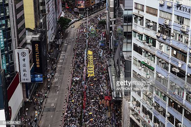 Protesters take part in a rally in Hong Kong on July 1 to mark the 19th anniversary of the former British colony's handover to China Protesters...