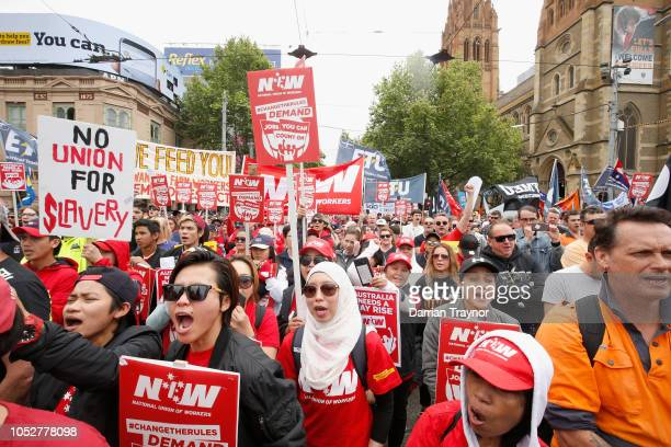 Protesters take part in a rally organised by the ACTU on October 23 2018 in Melbourne Australia The rally is part ACTU's Change the Rules campaign...