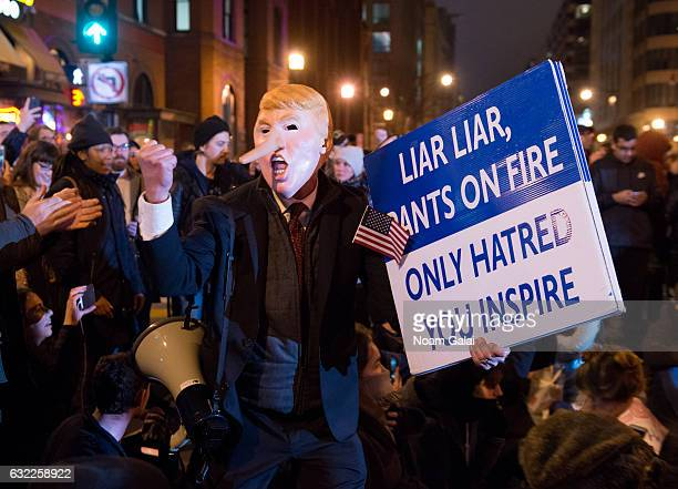 Protesters take part in a rally to protest against the President Donald J Trump's Inauguration on January 20 2017 in Washington DC