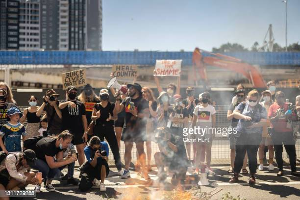Protesters take part in a smoking ceremony outside Queensland Police Headquarters on April 10, 2021 in Brisbane, Australia. The national day of...