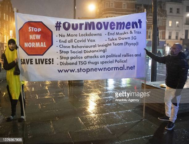 Protesters take part in a street party demonstration in Camden Town against the Covid-19 regulations affecting the hospitality industry in London,...