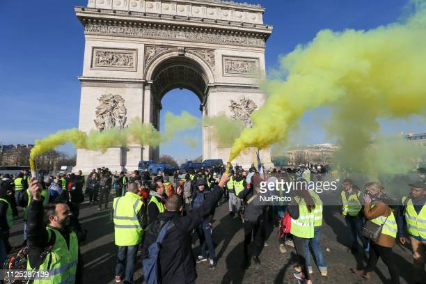 Protesters take part in a Yellow vest antigovernment demonstration on February 16 2019 in Paris on the Champs Elysées in front of the Arc de Triomphe...