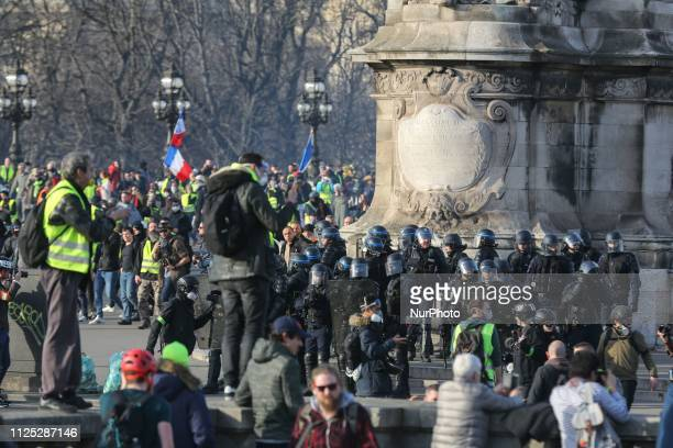 Protesters take part in a Yellow vest antigovernment demonstration on February 16 2019 in Paris on the Pont Alexandre III Demonstrators hit French...
