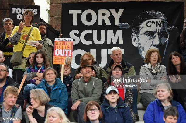 Protesters take part in an antiausterity demonstration organised by The People's Assembly in Manchester to coincide with the first day of the...