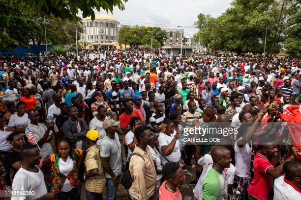 Protesters take part in an anti-government demonstration, on June 7 in Liberia's capital Monrovia. - Thousands of people took to the streets of...