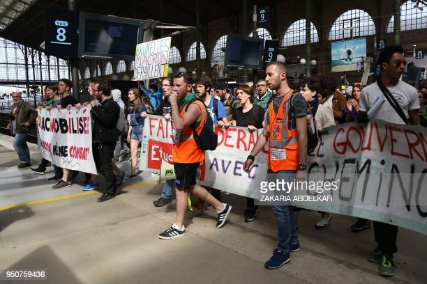 Protesters take part in an unofficial demonstration against the French Government's plans to overhaul the stateowned rail operator SNCF and in...
