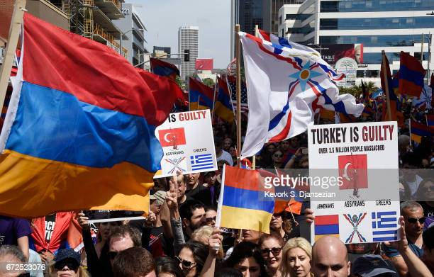 Protesters take part in march and rally commemorating the 102nd anniversary of the Armenian genocide outside the Turkish consulate on April 24 2017...