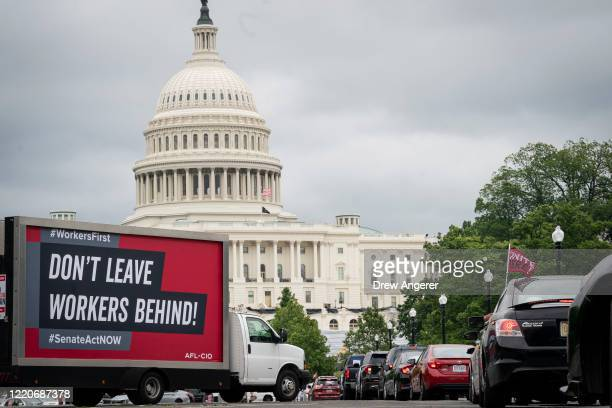 Protesters take part in the AFL-CIO Workers First Caravan for Racial and Economic Justice near the U.S. Capitol on June 17, 2020 in Washington DC....