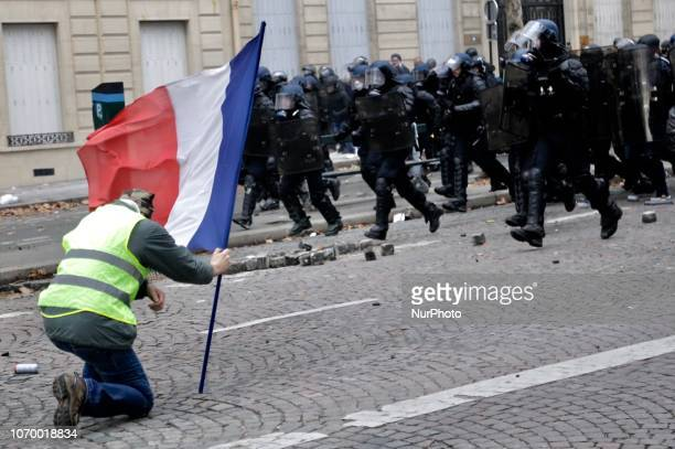 Protesters take part in the demonstration of the yellow vests on the Friedland Avenue on December 08 2018 in Paris France The 'Yellow Vest' protests...