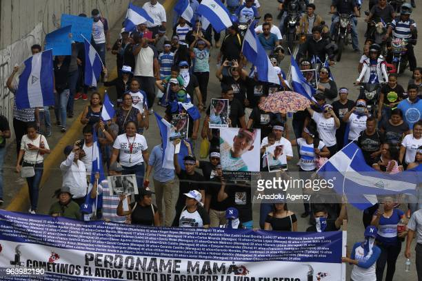 Protesters take part in the march of mothers' day called in memory of the dead and disappeared during the 42 days of crisis that has affected the...