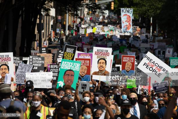 Protesters take part in the March On Georgia, organized by NAACP, on June 15, 2020 in Downtown Atlanta, Georgia. The march comes in response to the...
