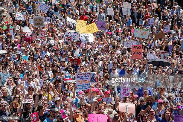 Protesters take part in the Melbourne rally to protest against the Trump Inauguration on January 21 2017 in Melbourne Australia The marches in...