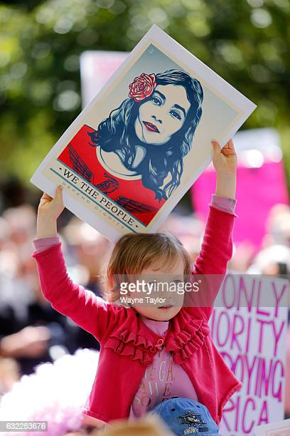 Protesters take part in the Melbourne rally to protest against the Trump Inauguration on January 21, 2017 in Melbourne, Australia. The marches in...