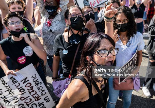 Protesters take part in the Women's March and Rally for Abortion Justice in Washington, DC, on October 2, 2021. - The abortion rights battle took to...
