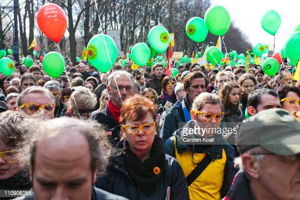 Protesters take part on a minute of silence to commemorate the victims of japans atomdisaster on March 26 2011 in Berlin Germany Antinuclear...