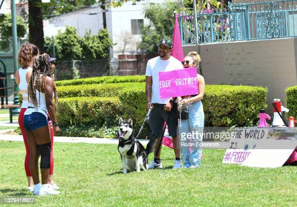 Protesters take pictures at the #FreeBritney March starting in Plummer Park on July 18, 2021 in West Hollywood, California. The group is calling for...