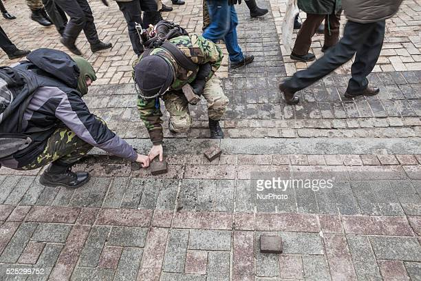 Protesters take stones of the street during demonstration of far right extremists in the streets of Kiev on 20th February 2016 during the 2nd...