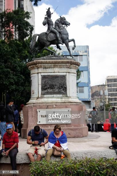 Protesters take the streets during the presidential inauguration ceremony of Honduran President Juan Orlando Hernandez at national stadium in...