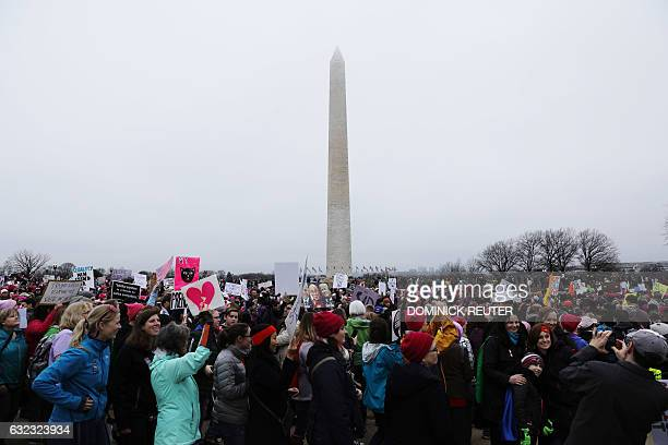 TOPSHOT Protesters take to the National Mall to demonstrate against the presidency of Donald Trump Washington DC on January 21 2017 Hundreds of...