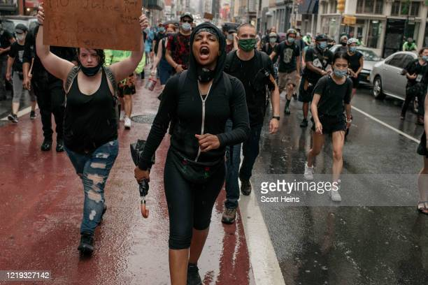 Protesters take to the street during a march against police brutality on June 11, 2020 in New York City. Demonstrations against systemic racism have...