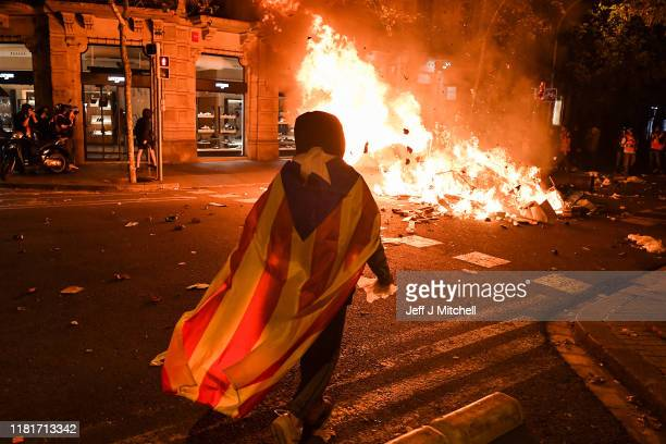 Protesters take to the streets to demonstrate after the Spanish Supreme Court sentenced nine Catalan separatist leaders to between 9 and 13 years in...