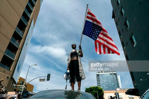 TOPSHOT A protesters takes a moment while speaking to the crowd as they march through Hollywood during a demonstration over the death of George Floyd...