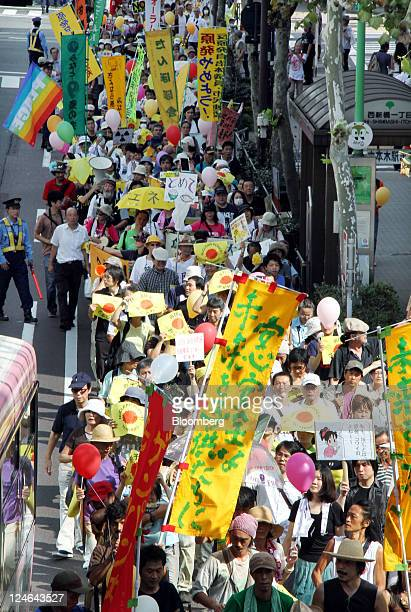 Protesters taking part in a rally against nuclear energy march near the Tokyo Electric Power Co headquarters in Tokyo Japan on Sunday Sept 11 2011...