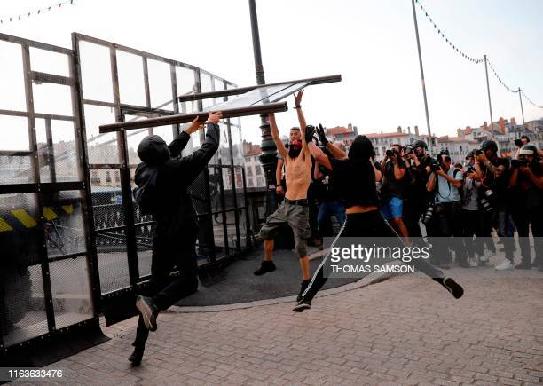 Protesters tear down a barricade during demonstration in the city of Bayonne southwest France on August 24 on the sidelines of the annual G7 Summit...