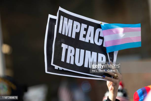 Protesters that support gay and transgender rights outside on 5th Avenue with signs that say IMPEACH TRUMP with a Pride flag after the 45th President...